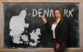 Teacher showing map of denmark on blackboard successful beautiful and confident young woman for presentation marketing research Stock Image