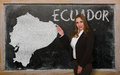 Teacher showing map of ecuador on blackboard successful beautiful and confident young woman for presentation marketing research Royalty Free Stock Images