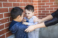 Teacher Stopping Two Boys Fighting In Playground Royalty Free Stock Photo