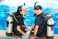 Teacher and student in a diving school asian people at the diver course wetsuit with an oxygen tank Royalty Free Stock Photo