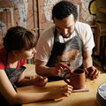 Teacher and student potters Royalty Free Stock Image