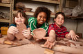 Teacher and students in clay studio Stock Image