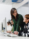 Teacher and students in college Royalty Free Stock Image