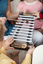 Teacher and students playing xylophone in class midsection of music Royalty Free Stock Photos