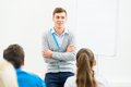 Teacher talking with students young men in the classroom Royalty Free Stock Photo