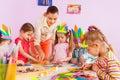Teacher teach preschool kids in art class Royalty Free Stock Photo