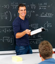 Teacher teaching mathematics in classroom Stock Images