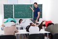 Teacher teaching mathematics to bored students Royalty Free Stock Photo