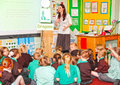 Teacher teaching primary schoolchildren female uk in class Stock Photos