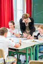 Teacher teaching students geography lessons in school or pupils having group work while lesson and the test or educate them class Royalty Free Stock Photo