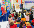 Teacher teaching to children in a kindergarten classroom Royalty Free Stock Photography