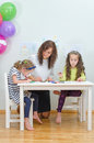 Teacher with two girls in kindergarten Royalty Free Stock Photo