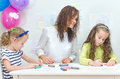 Teacher with two girls in kindergarten Royalty Free Stock Images