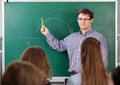 Teacher at university in front of a chalkboard Royalty Free Stock Image