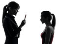 Teacher woman mother teenager girl discussion  in silhouette Stock Image