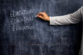 Teacher writing on blackboard Royalty Free Stock Photo