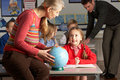 Teachers Giving Geography Lesson To Children Royalty Free Stock Photo
