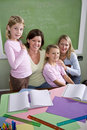 Teachers and students in classroom Royalty Free Stock Image