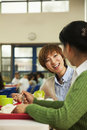 Teachers talking at lunch in school cafeteria Royalty Free Stock Photography