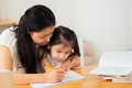 Teaching to write mother her daughter how Stock Photo