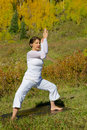 Teaching yoga in autumn a woman the scenic colorado mountains fall Stock Photos