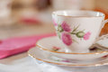 Teacup pink gold gilded and place setting Royalty Free Stock Image