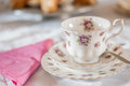 Teacup purple and gold gilded and place setting Stock Images