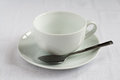 Teacup saucer white tablecloth Royalty Free Stock Photo