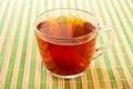 Teacup on straw napkin. Stock Photo