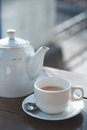 Teacup and teapot on the table at outdoors cafe Royalty Free Stock Image