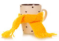 Teacup tied with a yellow scarf isolated on white Royalty Free Stock Photo