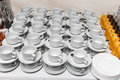 Teacups empty tea cups and glasses with juice Royalty Free Stock Photos