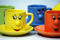 Teacups with faces Stock Photography