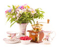 Teacups, raspberry, coffee grinder Royalty Free Stock Photography