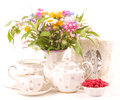 Teacups, raspberry and flowers Royalty Free Stock Photo