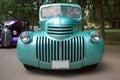 Teal hot rod car at a car show. Royalty Free Stock Photo