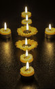 Tealight candles multiple at night on table Stock Photos