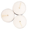 Tealights candles ix small over white background Stock Image