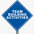 Team building activities text on a blue road sign white background Royalty Free Stock Photos
