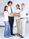 Team of business people with their hands together Royalty Free Stock Images