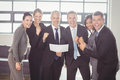 Team of businesspeople with certificate Royalty Free Stock Photo