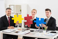 Team Of Businesspeople Holding Jigsaw Puzzle Royalty Free Stock Photo