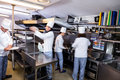 Team of chefs preparing food in the kitchen a restaurant Royalty Free Stock Images