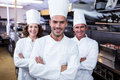 Team of chefs standing with arms crossed Royalty Free Stock Photo
