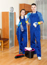 Team cleaning in room man and women at home Royalty Free Stock Photography