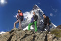 Team of climbers walks against alpine background Royalty Free Stock Photo