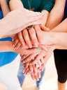Team concept hands of a group of people together forming a unity Stock Photos