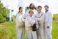 Team of confident beekeepers at apiary male and female standing together Royalty Free Stock Photos