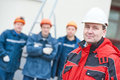 Team of construction workers technicians with foreman in front Royalty Free Stock Photo