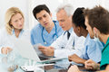 Team of doctors examining reports Imagem de Stock